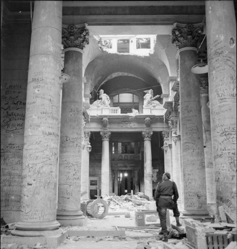 Ruins of the German Reichstag building in Berlin, Germany, covered with graffiti from Soviet soldiers, 3 Jul 1945 (Imperial War Museum: 4700-30 BU 8582)