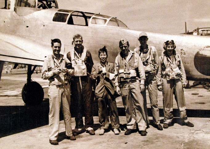 Lt. Cdr. Don Thorburn, Lt. Cdr. E.V. Wedell, interpreter S. Toda, Lt. Cdr. John MacInnes, Lt. W.V. Ballow, and Lt. Cdr. Cliff McDowell at Atsugi Airfield, Japan, 28 Aug 1945 (National Museum of the US Navy: 80-G-490418)