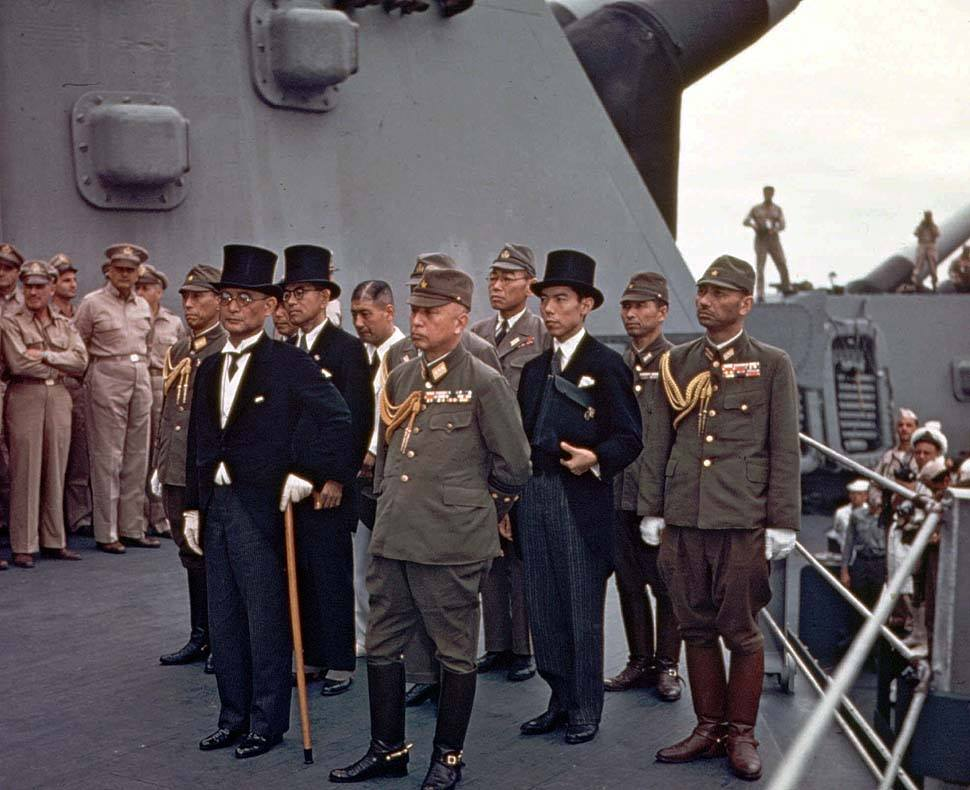 The Japanese delegation arriving aboard USS Missouri, Tokyo Bay, for the surrender ceremony, 2 September 1945 (US National Archives: USA C-2719)