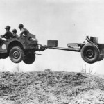Bantam jeep, towing a 37 mm Gun M3 piece, jumping over a small hill, New River, NC, 1941 (Library of Congress)