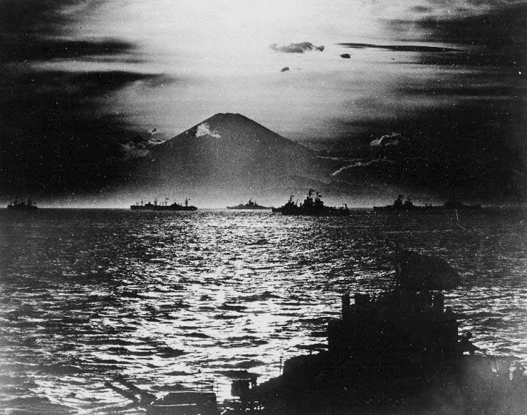 US and British warships in Sagami Bay, Japan, 27 Aug 1945; note Mount Fuji with setting sun in background; photo taken from battleship USS South Dakota (US National Archives: 80-G-490487)
