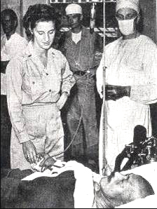 Hideki Tojo being treated by US medical personnel in Tokyo, Japan after his failed suicide attempt, 11 September 1945 (public domain via WW2 Database)