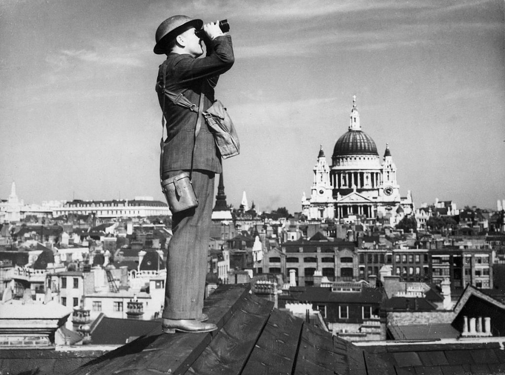 British Observer Corps aircraft spotter on the roof of a building in London during the Battle of Britain, with St. Paul's Cathedral in the background (US National Archives: 541899)