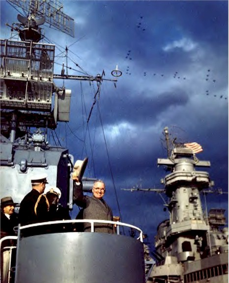 Pres. Harry Truman aboard USS Renshaw during Navy Day Fleet Review, New York City, 27 Oct 1945; note USS Missouri's superstructure in background and US Navy aircraft in formation above (US Navy photo: K-15861)