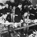 Galeazzo Ciano of Italy, Joachim von Ribbentrop of Germany, and Saburō Kurusu of Japan signing the Tripartite Pact at the Reich Chancellery in Berlin, 27 Sep 1940 (public domain via WW2 Database)