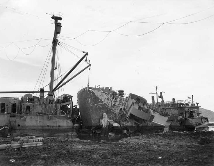 USS Ocelot aground in Buckner Bay, Okinawa, with her stern severed by USS Nestor after Typhoon Louise ravaged that port 9 October 1945. Nestor's bow is in the center of this photo. (US Naval History & Heritage Command)