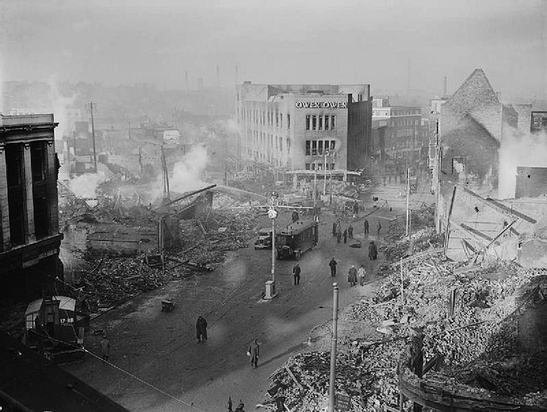 Broadgate in Coventry city centre following the Coventry Blitz of 14/15 November 1940. The burnt-out shell of the Owen Owen department store (which had only opened in 1937) overlooks a scene of devastation, 16 November 1940 (Imperial War Museum: H 5600)