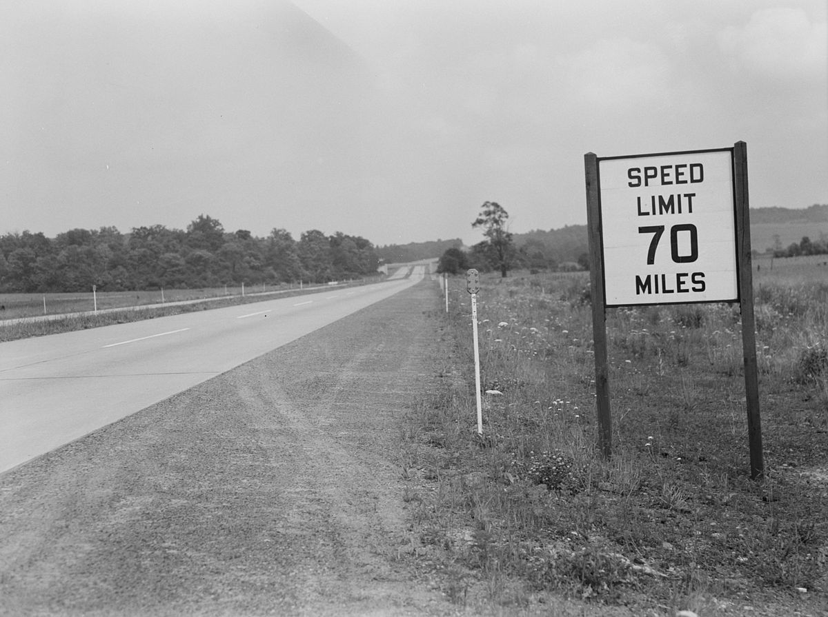 "Pennsylvania Turnpike, September 1942, with prewar 70 mph speed limit sign still in place after wartime ""Victory speed limit"" enacted (Library of Congress: fsa 8b07393)."