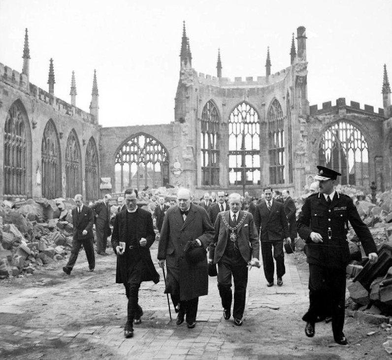 Winston Churchill in the ruined nave of Coventry Cathedral, England, severely damaged in air raid, 14–15th November 1940 (Imperial War Museum: H 14250)