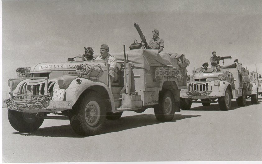 Two Long Range Desert Group trucks armed with water cooled Vickers guns (British government photo)