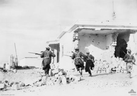 Australian troops rushing through the streets of Bardia, Libya, 4 Jan 1941 (Australian War Memorial: 006083)