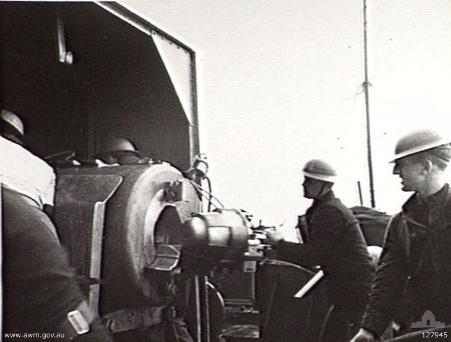 Crew of gunboat HMS Ladybird operating a 6-inch 50-caliber Mk XIII gun during the bombardment of Bardia, Libya, 2 Jan 1941 (Australian War Memorial: 127945)