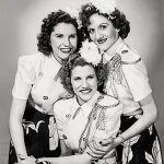 The Andrews Sisters: Maxene (top left), LaVerne (top right), and Patty (center), October 1943 (public domain via Billboard 1943 Music Yearbook and Wikipedia)