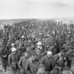Italian prisoners captured during the assault on Bardia, Libya, march to a British army base on 6 January 1941 (Imperial War Museum: E 1579)