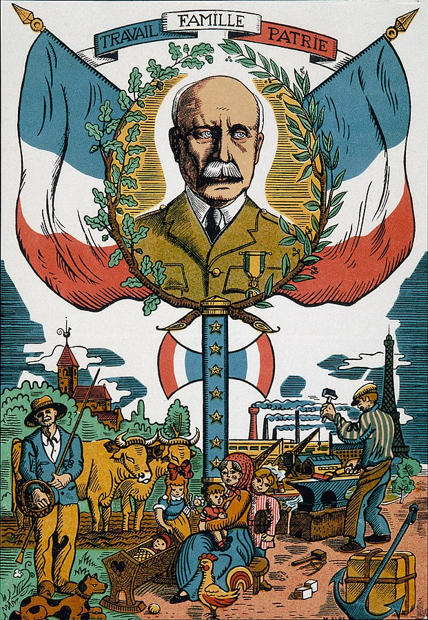 "Vichy propaganda poster featuring Marshal Pétain and Vichy motto ""Travail, Famille, Patrie"" (work, family, fatherland) [Public domain via Wikipedia]"