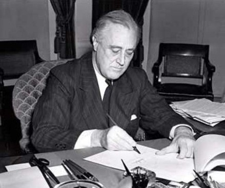 Pres. Franklin Roosevelt signing the Lend-Lease Bill, 11 Mar 1941 (Library of Congress: LC-USZ62-128765)