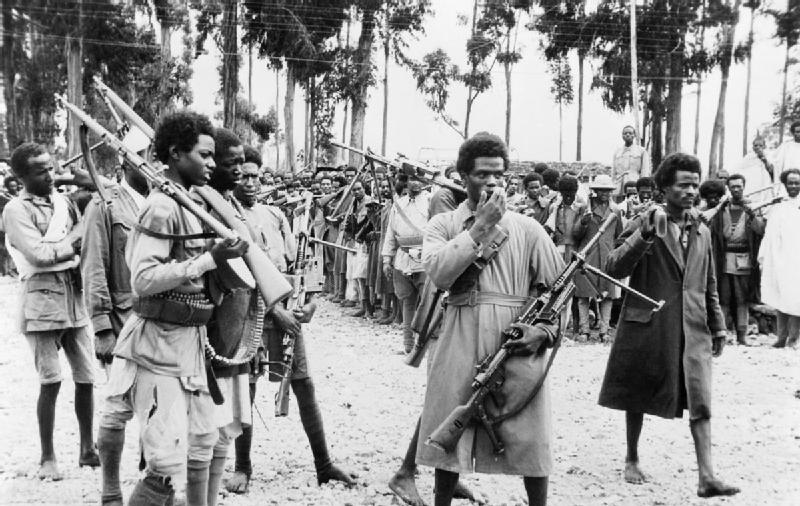 Ethiopian men gather in Addis Ababa to hear proclamation announcing return of Emperor Haile Selassie in May 1941 (Imperial War Museum: K 325)