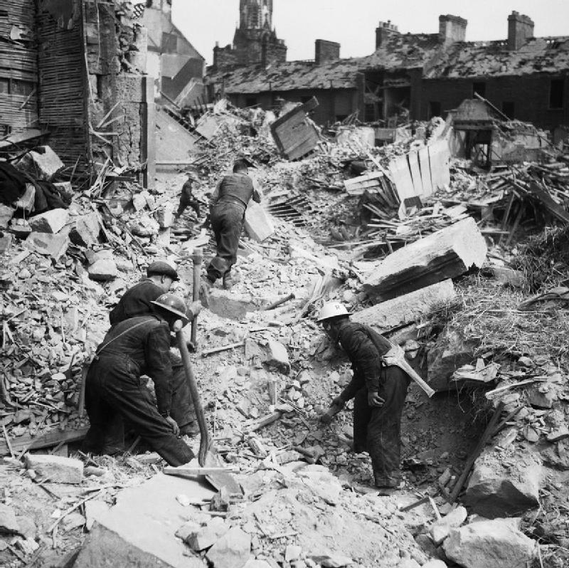 Rescue workers search through the rubble of Eglington Street in Belfast, Northern Ireland, after a German Luftwaffe air raid, 7 May 1941 (Imperial War Museum: H 9476)