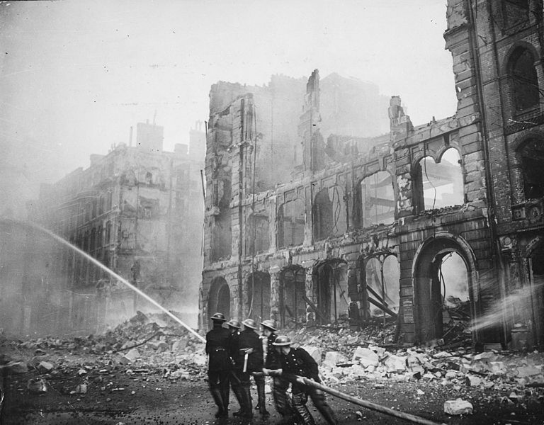 Firefighters putting out a blaze in London after an air raid during The Blitz in 1941 (US National Archives: 541902)