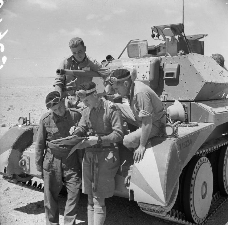 Crew of a British Cruiser Mk IV tank studying a map in the Western Desert, Egypt, 30 Apr 1941 (Imperial War Museum: E 2640)