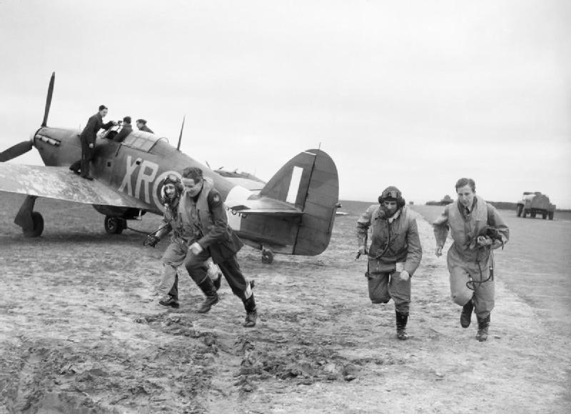 American pilots of No 71 'Eagle' Squadron rush to their Hurricanes at Kirton-in-Lindsey, 17 March 1941 (Imperial War Museum: CH 2401)