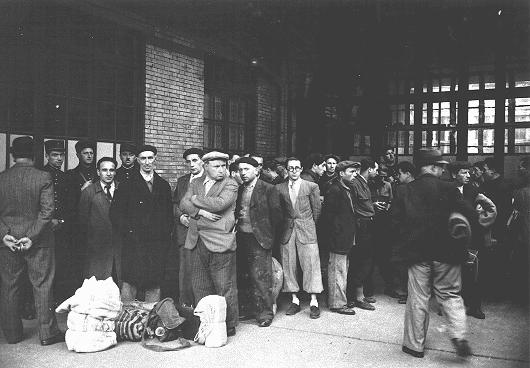 After the first roundup in Paris, French police escort foreign Jewish men from the Japy school to deportation trains at the Austerlitz station, Paris, France, May 14, 1941 (Bibliotheque Historique de la Ville de Paris via US Holocaust Museum)