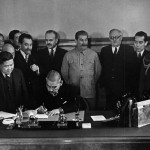 Japanese Foreign Minister Matsuoka signing the Soviet-Japanese Neutrality Pact, 13 Apr 1941, Molotov and Stalin in background (public domain)