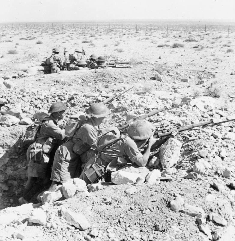 Australian troops in a foxhole near Tobruk, Libya, 13 Aug 1941 (Imperial War Museum: E 4792)