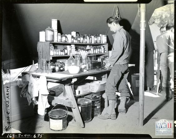 Soldier pharmacist at his work bench in the pharmacy at Hunter Liggett Military Reservation, 1944 (US Army photo via National WWII Museum)