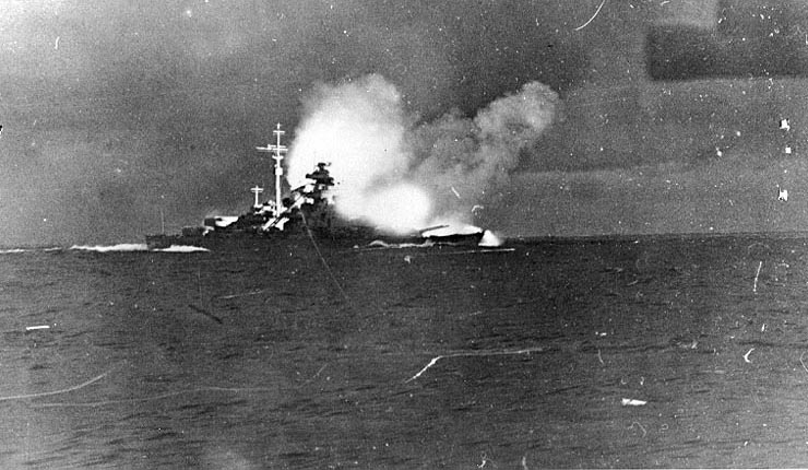 Bismarck firing on Hood and Prince of Wales, Battle of Denmark Strait, 24 May 1941 (US Naval History and Heritage Command: NH 69730)