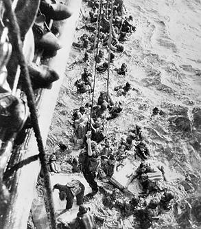 Survivors of battleship Bismarck being pulled aboard HMS Dorsetshire, 27 May 1941 (Imperial War Museum: 4700-26 ZZZ 3130C)