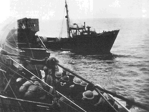 HMS Tartar's boarding party prepares to board German weather ship Lauenburg, 28 June 1941 (Imperial War Museum)