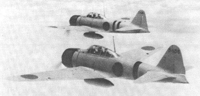 Two Japanese A6M2 Zero fighters en route to attack Nanzheng, China, 26 May 1941 (public domain via Wikipedia)