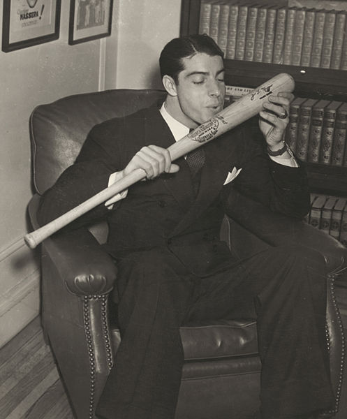 Joe DiMaggio kissing his bat, 15 Dec 1941 (Library of Congress)