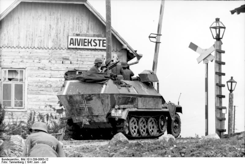 German SdKfz. 251/1 halftrack vehicle at a rail crossing, Aiviekstes, Latvia, Jun 1941 (German Federal Archive: Bild 101I-209-0063-12)