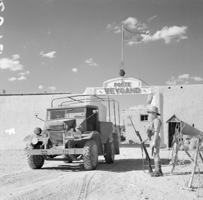 A 15-cwt truck passes a sentry as it leaves Fort Weygand at Palmyra, Syria, 12 July 1941 (Imperial War Museum: E 4079)