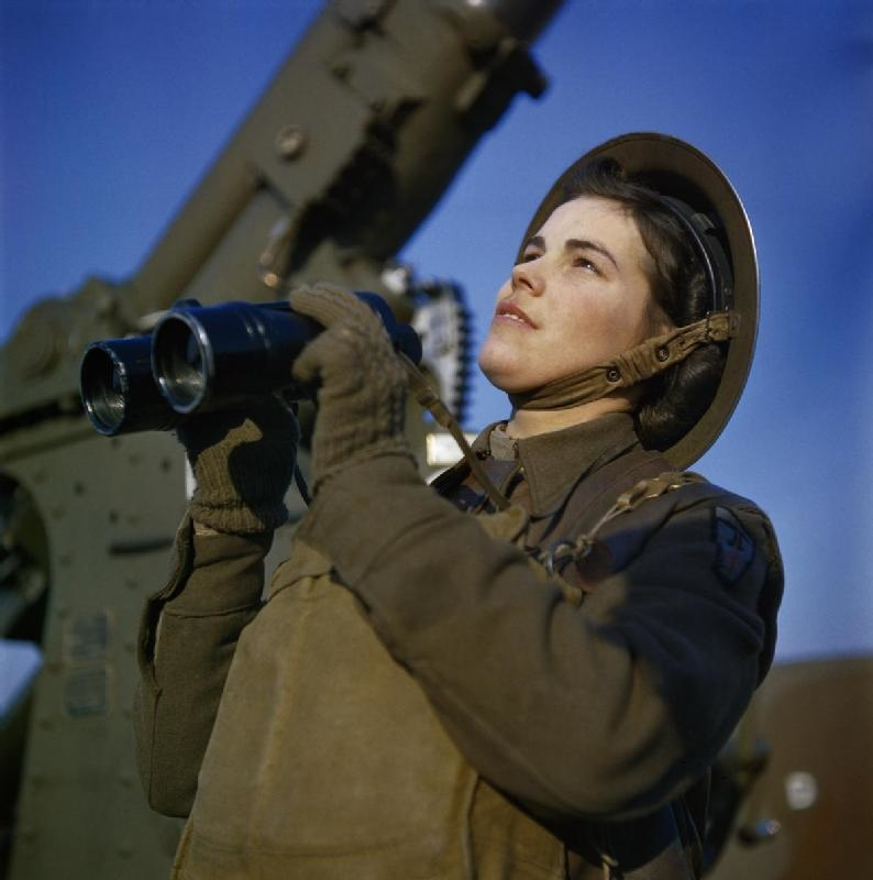 A member of the ATS (Auxiliary Territorial Service) serving as a spotter with a 3.7-inch anti-aircraft gun battery, December 1942 (Imperial War Museum: TR 452)