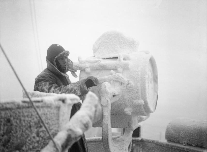 Ice forming on 20-inch signal projector on cruiser HMS Sheffield while she escorts an Arctic convoy to Russia, December 1941 (Imperial War Museum: A 6872)