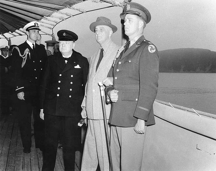 Winston Churchill, Franklin Roosevelt, and Roosevelt's sons Franklin and Elliott aboard USS Augusta off Newfoundland, Aug 1941 (US Naval History and Heritage Command: NH 67201)