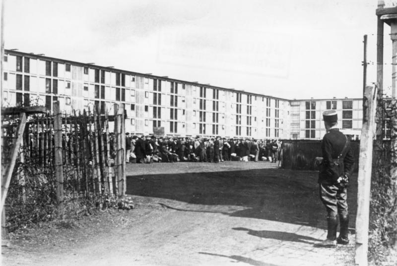 Accommodation block at Drancy with French gendarme on guard, Aug. 1941 (German Federal Archive, Bild 183-B10919)