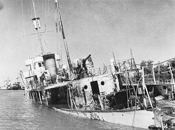 Iranian gunboat Babr after being shelled by the British Navy during the invasion of Iran, 25 August 1941 (Iranian govt photo, public domain)