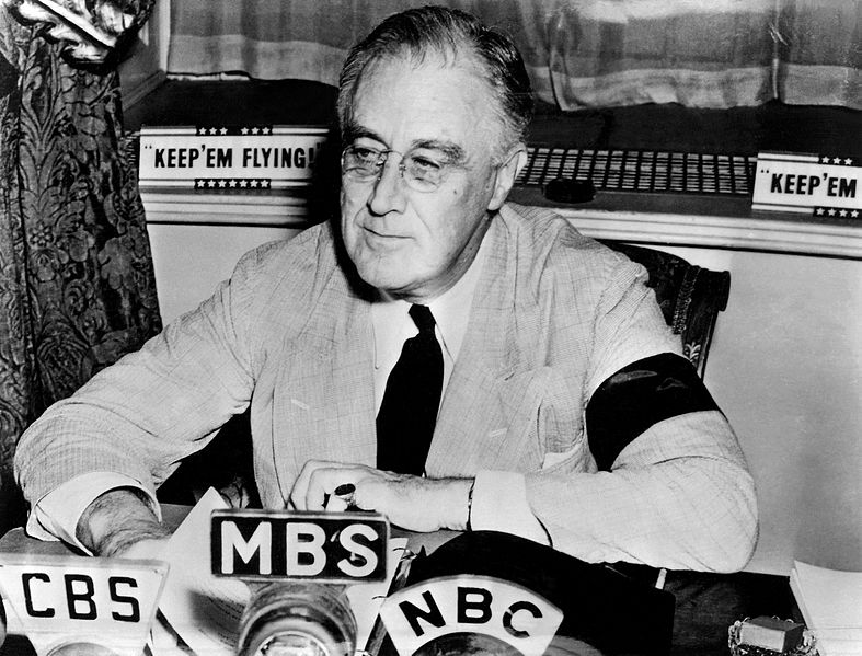 Franklin D. Roosevelt at the White House, delivering radio address, 11 September 1941. Note his black armband for his mother's death four days before (US National Archives: 197058)