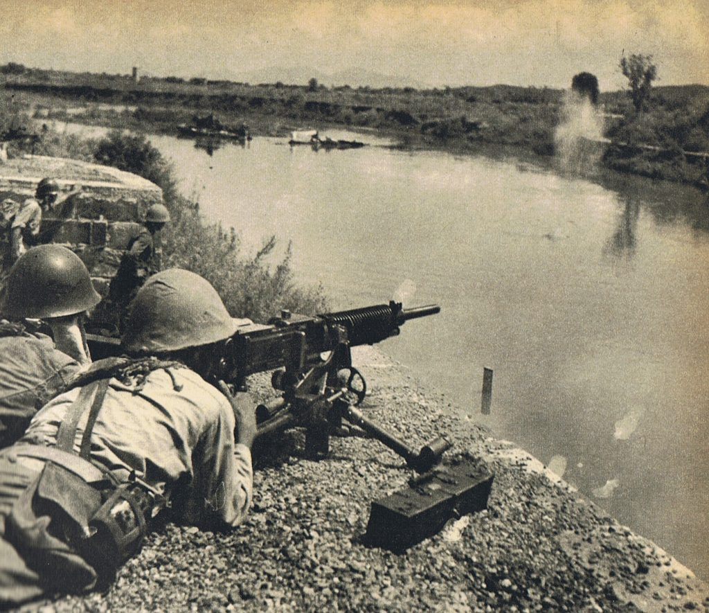 Soldiers of Japanese 4th Division man Type 92 heavy machine gun near Miluo River in China, Second Battle of Changsha, 22 or 23 Sep 1941 (public domain via Wikipedia)