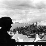 German sentinel in the citadel of Kiev with the burning Dnieper River Bridge in the background, 20 September 1941 (German Federal Archive: Bild 183-L20208)