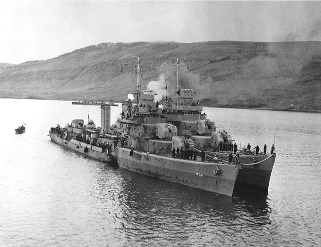 Destroyer USS Kearny at Reykjavik, Iceland, 19 October 1941, two days after being torpedoed by U-568; destroyer USS Monssen is alongside; note the torpedo hole (US Naval History and Heritage Command: 80-G-28788)