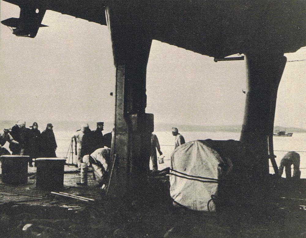 Sailors of carrier Zuikaku winching up the anchor, Itrup, Kurile Islands, 26 Nov 1941; en route to attack Pearl Harbor (public domain via WW2 Database)
