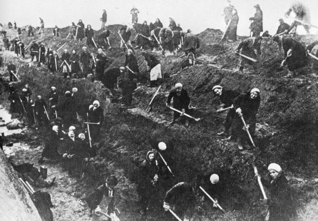 Women and elderly men from Moscow digging tank trap outside the city, Oct. 1941 (public domain via United States Information Agency)