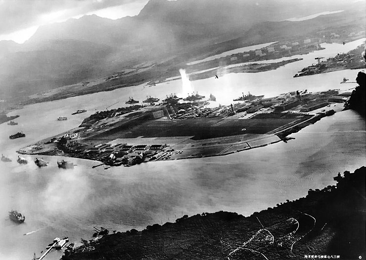 Aerial view of Ford Island in Pearl Harbor during the Japanese attack, 7 Dec 1941; photo taken from a Japanese aircraft (US Naval History & Heritage Command)