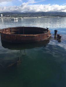 USS Arizona, viewed from the memorial; note the oil on the water (Photo: Sarah Sundin, 7 Nov 2016)