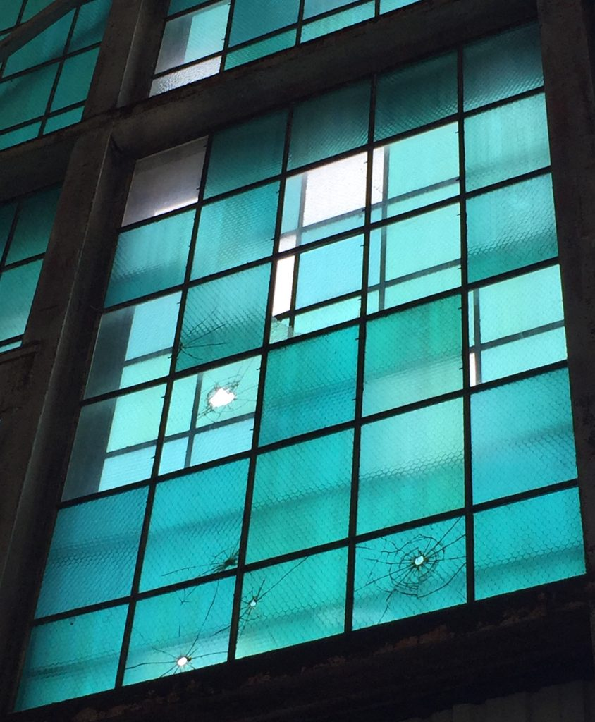 Window in Hangar 79 at the Pacific Aviation Museum, showing bullet damage from the attack on Pearl Harbor (Photo: Sarah Sundin, 7 Nov 2016)